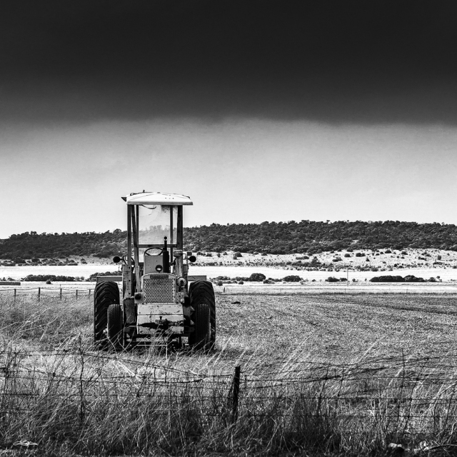 A tractor sitting in a paddock