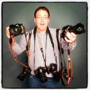 Leigh Diprose holding six Sony A99 full frame cameras