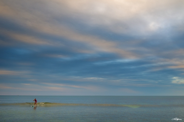 A paddle boarder at Cottesloe Beach